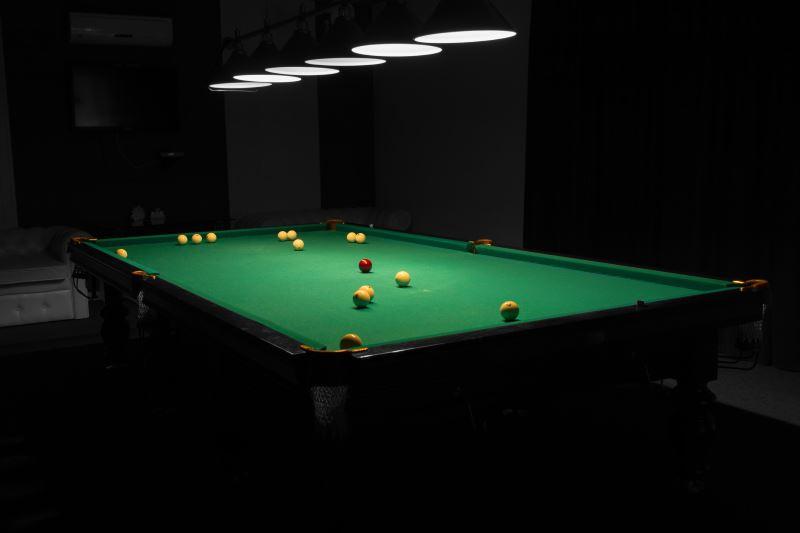 8 ft slate pool table in dark room