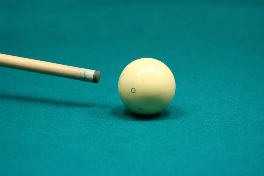pool cue and ball on table